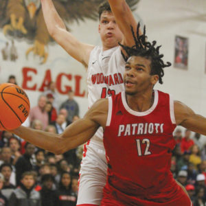 Sandy Creek boys lose to Woodward, 58-56, in epic battle